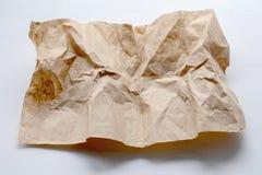 Ένα κομμάτι του τσαλακωμένου χαρτί για ένα ελαφρύ υπόβαθρο στοκ φωτογραφίες με δικαίωμα ελεύθερης χρήσης
