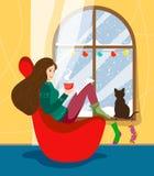 Ένα κορίτσι κάθεται σε μια καρέκλα από το χειμερινό παράθυρο που διακοσμείται με τις γιρλάντες και διαβάζει ένα βιβλίο με μια κού ελεύθερη απεικόνιση δικαιώματος