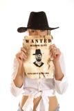Ένα κορίτσι wester σε ένα καπέλο που κρατά ένα επιθυμητό σημάδι Στοκ εικόνες με δικαίωμα ελεύθερης χρήσης