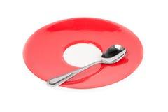 Ένα κουτάλι στο πιάτο Στοκ Φωτογραφίες