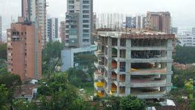 Ένα κτήριο που είναι στην οικοδόμηση σε Medellin, εκδοτική περιεκτικότητα σε Κολομβία φιλμ μικρού μήκους