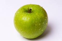 Ένα μήλο που απομονώνεται πράσινο Στοκ Φωτογραφίες