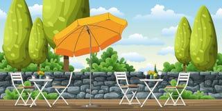 Ένα πεζούλι με τους πίνακες και τις καρέκλες Στοκ εικόνες με δικαίωμα ελεύθερης χρήσης