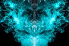 Ένα πολύχρωμο σχέδιο του μπλε και πράσινου καπνού μιας μυστικής μορφής υπό μορφή προσώπου και κεφαλιού ή παράξενου πλάσματος ο φα απεικόνιση αποθεμάτων