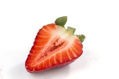 Ένα που κόβεται στη φράουλα halfs στο λευκό Στοκ εικόνα με δικαίωμα ελεύθερης χρήσης