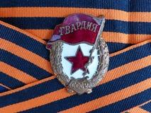Ένα σημάδι ` φρουρεί ` στην κορδέλλα του ST George ` s closeup heirloom μνήμη η ημέρα 9 μπορεί νίκη Απονέμει grandfath στοκ εικόνα με δικαίωμα ελεύθερης χρήσης