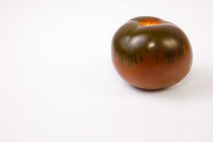 Ένα σκούρο πράσινο kumato tomatoe Στοκ Φωτογραφίες