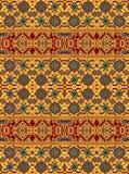 Ένα σχέδιο των floral και γεωμετρικών στοιχείων για τον τάπητα, τοποθέτηση στο κρεβάτι στοκ φωτογραφία