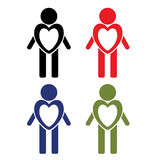 Ένα σύνολο ατόμων στα διαφορετικά χρώματα με μια αφιερωμένη καρδιά Εικονίδια: Αγάπη, υγεία και βοήθεια Στοκ Φωτογραφία