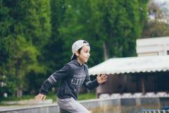 Ένα τρέχοντας αγόρι στοκ εικόνα