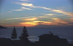 Ένα τρελλό ηλιοβασίλεμα κατά τις απόψεις της Νέας Ζηλανδίας Στοκ Εικόνες