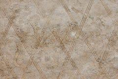 Ένα υπόβαθρο που αποτελείται από τις γεωμετρικές μορφές Ένας τοίχος των καφετιών rhombuses Στοκ Φωτογραφία