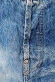 Ένα φερμουάρ στα τζιν στοκ εικόνα