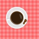 Ένα φλιτζάνι του καφέ στον πίνακα Στοκ Φωτογραφίες