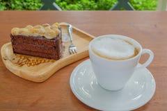 Ένα φλιτζάνι του καφέ και ένα κέικ Στοκ Εικόνες