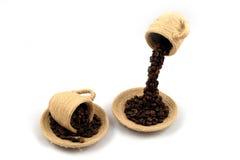 Ένα φλυτζάνι με τα φασόλια καφέ Στοκ Εικόνες