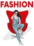 Ένα όμορφο κορίτσι στις φόρμες τζιν κάθεται σε μια καρέκλα Διανυσματική απεικόνιση για την κάρτα ή αφίσα, τυπωμένη ύλη για τα ενδ διανυσματική απεικόνιση