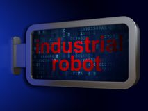 Έννοια βιομηχανίας: Βιομηχανικό ρομπότ στο υπόβαθρο πινάκων διαφημίσεων Στοκ Εικόνα