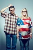Έννοια εγκυμοσύνης: πορτρέτο δύο hipsters Στοκ Φωτογραφίες