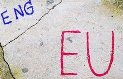 Έννοια δημοψηφισμάτων της βρετανικής ΕΕ Brexit με τα Η.Ε λέξης και Eng στον τοίχο πετρών στοκ φωτογραφία