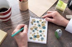 Έννοια δικτύων νομίσματος σε ένα σημειωματάριο Στοκ εικόνα με δικαίωμα ελεύθερης χρήσης