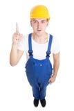 Έννοια ιδέας - αστείος οικοδόμος ατόμων σε ομοιόμορφο που απομονώνεται μπλε στο whi Στοκ φωτογραφία με δικαίωμα ελεύθερης χρήσης