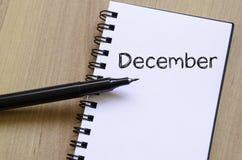 Έννοια κειμένων Δεκεμβρίου στο σημειωματάριο Στοκ Φωτογραφία