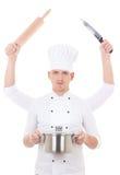 Έννοια μαγειρέματος - νεαρός άνδρας στον αρχιμάγειρα ομοιόμορφο με τέσσερα χέρια που κρατούν τον εξοπλισμό κουζινών Στοκ Φωτογραφία