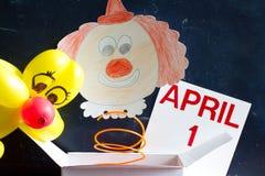 Έννοια συμβόλων ημέρας ανόητων Απριλίου με τον κλόουν Στοκ φωτογραφία με δικαίωμα ελεύθερης χρήσης