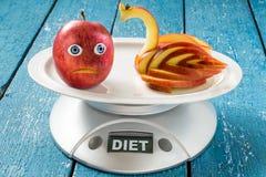 Έννοια της απώλειας διατροφής και βάρους: Apple - Κύκνος Στοκ φωτογραφία με δικαίωμα ελεύθερης χρήσης