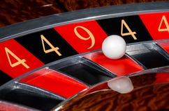 Έννοια της τυχερής ρόδας μαύρο και κόκκινο SEC αριθμών ρουλετών χαρτοπαικτικών λεσχών Στοκ Εικόνα