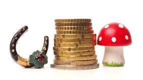 Έννοια της τύχης με τα συσσωρευμένα νομίσματα Στοκ Εικόνες