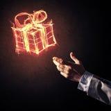 Έννοια του εορτασμού με το καίγοντας σύμβολο και την επιχείρηση δώρων πυρκαγιάς Στοκ Φωτογραφία