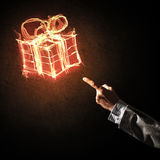 Έννοια του εορτασμού με το καίγοντας σύμβολο και την επιχείρηση δώρων πυρκαγιάς Στοκ Εικόνες