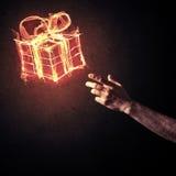 Έννοια του εορτασμού με το καίγοντας σύμβολο και το creatio δώρων πυρκαγιάς Στοκ φωτογραφία με δικαίωμα ελεύθερης χρήσης