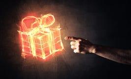 Έννοια του εορτασμού με το καίγοντας σύμβολο και το creatio δώρων πυρκαγιάς Στοκ Εικόνα