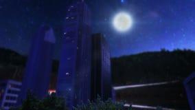 Δέντρα και κτήρια μέσα στο στρογγυλό έδαφος τη νύχτα με τις θαμπάδες απόθεμα βίντεο