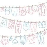 Ένωση ιματισμού μωρών στο σχοινί μετά από την πλύση ελεύθερη απεικόνιση δικαιώματος