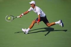 Έξι φορές ο πρωτοπόρος Novak Djokovic του Grand Slam κατά τη διάρκεια της ημιτελικής αντιστοιχίας στις ΗΠΑ ανοίγει το 2014 Στοκ φωτογραφία με δικαίωμα ελεύθερης χρήσης