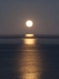 Έξοχα σύνολα φεγγαριών πέρα από το Ειρηνικό Ωκεανό Στοκ Φωτογραφία