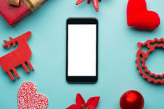 Έξυπνη τηλεφωνική χλεύη επάνω με τις αγροτικές διακοσμήσεις Χριστουγέννων για app την παρουσίαση επάνω από την όψη Στοκ Εικόνα