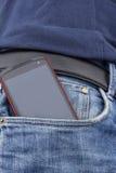 Έξυπνο τηλέφωνο σε μια τσέπη Στοκ Φωτογραφία