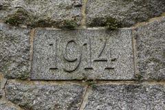 Έτος 1914 που χαράζεται στην πέτρα Τα έτη Πρώτου Παγκόσμιου Πολέμου Στοκ Φωτογραφίες