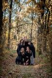 Έφηβοι στα κοστούμια αποκριών στα ξύλα στοκ φωτογραφία