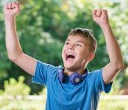 έφηβος ακουστικών αγορ&io Στοκ φωτογραφία με δικαίωμα ελεύθερης χρήσης
