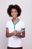 Έφηβος με την ψηφιακή ταμπλέτα. Στοκ εικόνες με δικαίωμα ελεύθερης χρήσης