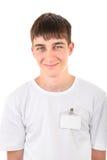 Έφηβος με το κενό διακριτικό Στοκ φωτογραφία με δικαίωμα ελεύθερης χρήσης