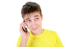 Έφηβος με το κινητό τηλέφωνο Στοκ Φωτογραφίες