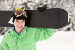 Έφηβος με το σνόουμπορντ στις διακοπές σκι Στοκ Φωτογραφία