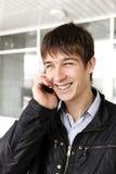 Έφηβος με το τηλέφωνο Στοκ Εικόνες